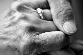 Caring Hand on Senior Hand